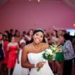 Pretty bride about to throw her bouquet - Demers - Carlea J Photo