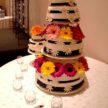 Floating Wedding Cake with Colorful Daisies