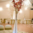 Red Flower Centerpiece w/ Green Decor
