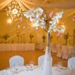 White Wedding Centerpiece with Pink Flowers